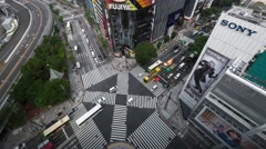 Bird's eye time-lapse footage of traffic at a street crossing in Ginza Stock Footage