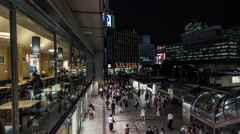 Time-lapse footage of pedestrian traffic in Shinjuku area at night, Tokyo, Japan Stock Footage