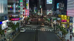 Zooming time-lapse footage of traffic in Shinjuku area at night, Tokyo, Japan Stock Footage