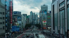 Day to night panning time-lapse footage of traffic in Shinjuku area Stock Footage