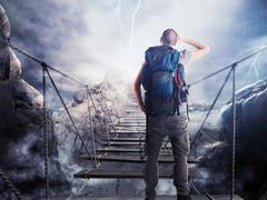 3D Rendering of explorer on unstable bridge - stock photo