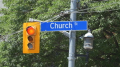 Church Street street sign and stoplight in Toronto, Ontario, Canada. Stock Footage