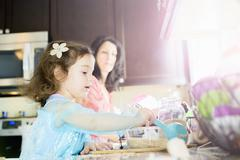 Female toddler and mother baking in kitchen Stock Photos