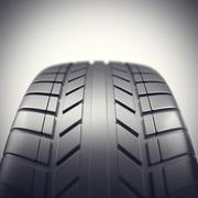 Car tire in close-up view with depth of field effect. 3d illustration Stock Illustration