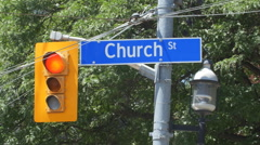 Church Street street sign and stoplight in Toronto, Ontario, Canada. Stock Footage