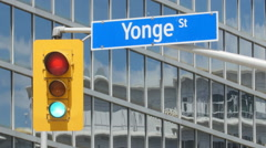 Yonge Street street sign with stoplight. Toronto, Canada. Stock Footage