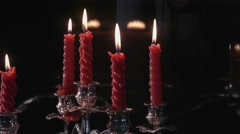 Burning candles go out in the wind. Panorama Stock Footage