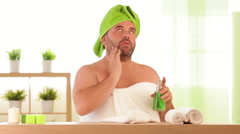 Overweight man applies beauty treatment at health spa Stock Footage
