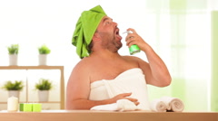 Overweight man drinks beauty cream at health spa - stock footage