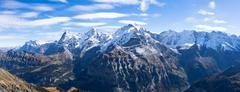 Snow scene on alpes mountains in cloud sky Stock Photos