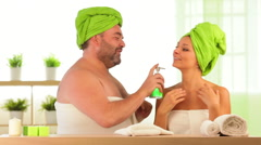 Overweight man and woman beauty treatment at health spa - stock footage