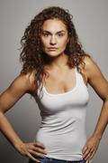 Portrait of woman in tank top - stock photo