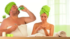 woman beauty treatment, overweight man drinks cream at health spa - stock footage
