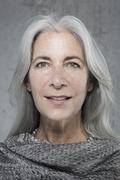 Portrait of beautiful mature woman with long grey hair Stock Photos