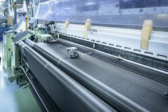 Carbon fibre loom in detail in carbon fibre factory Stock Photos