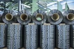Rows of carbon fibre in carbon fibre factory Stock Photos