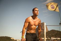 Mid adult man training on parallel bars, Rio De Janeiro, Brazil Kuvituskuvat