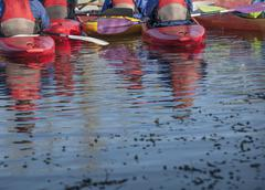 Group of people in kayaks, rear view - stock photo