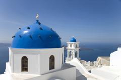 View of white washed church with blue domes, Oia, Santorini, Cyclades, Greece Stock Photos