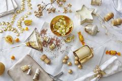 White and gold colored still life with confectionery and variety of objects - stock photo