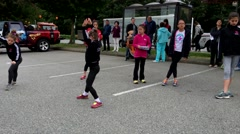 Children turn a somersault on Festival Coquitlam Grand Parade - stock footage