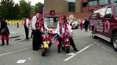 Gizeh shriners group of old people display small motorcycle - stock footage
