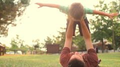 Happy child play with dad at sunset park summer outdoor Stock Footage
