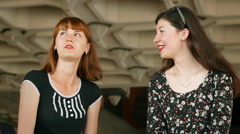 Two beautiful girls talk about their lives close-up Stock Footage
