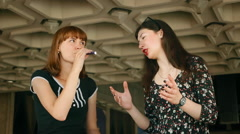 Girl tells her story vigorously girl who smokes an electronic cigarette Stock Footage