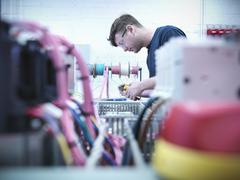 Electrical engineer assembling switch board in engineering factory Stock Photos