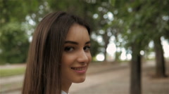 Follow me girl concept. Young pretty happy student model smiling and walking in Stock Footage