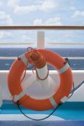 Life preserver on ship deck - stock photo