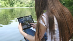 Woman browsing photos, using app and communicating outdoors. Stock Footage