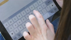 Girls fingers touching virtual keys form a digital keyboard of a tablet Stock Footage