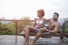 Couple enjoying swimming pool Stock Photos