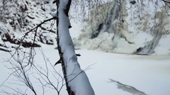 Waterfall in the winter forest. Old micro hydro power plant Stock Footage