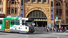Busy intersection facing Flinders street station Stock Footage