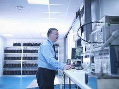 Electromagnetic compatibility engineer carrying out radiated emissions scan on Stock Photos