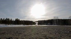 SUV driving on a snow-covered road. Sunset - stock footage