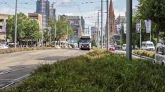 Trams approaching station on St. Kilda Road, Melbourne Stock Footage