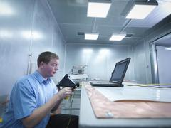 Engineer carrying out electro static discharge (ESD) testing using air discharge - stock photo