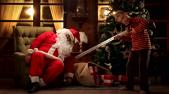 Children kill Santa Claus and rob his gifts Stock Footage