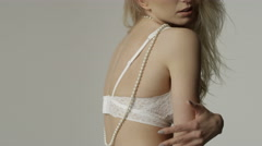 Portrait of a beautiful sexy blonde woman wearing white underwear. - stock footage