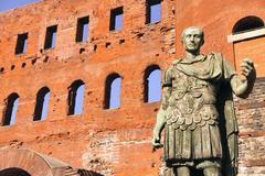 Ancient Roman bronze statue of Emperor Augustus, Porte Palatine city gate, - stock photo