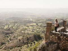 Mid adult woman standing on balcony, looking at view, Mijas, Andalucia, Spain - stock photo