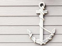 Wooden anchor on wall vintage background Stock Photos