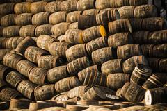 Pile of wooden whisky casks - stock photo