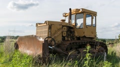 Old yellow tractor/excavator. Time lapse footage. Nature background. - stock footage