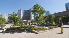 Trees with Nathan Phillips square and city hall behind. Toronto. Stock Footage