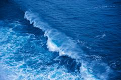 Detail of tidal ocean wave and sea Stock Photos